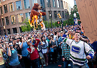 A rowdy crowd burns a bear signifying the Bruins on the downtown streets of Vancouver,BC after the Canucks were defeated by the Boston Bruins in the Stanly Cup on June 15, 2011. (photo copyright Karen Ducey)