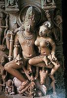 "India: Shiva's Family, 10th C.  The 4-armed god holds symbolic devices with upper arms; lower right holds ""Lotus of Dalliance""  lower left his wife Uman's breast.  Below left, his son, the elephant-headed Ganesa."