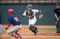 Bristol Pirates catcher Tomas Morales (54) chases Luke Doyle (18) of the Johnson City Cardinals back towards third base at Boyce Cox Field on July 7, 2015 in Bristol, Virginia.  The Cardinals defeated the Pirates 4-1 in game one of a double-header. (Brian Westerholt/Four Seam Images)