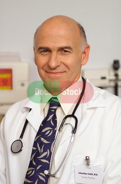 smiling portrait of older, elder male doctor