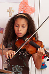 8 year old girl at home musical instrument practice portrait playing violin