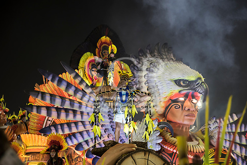 Imperatriz Leopolinense Samba School, Carnival, Rio de Janeiro, Brazil, 26th February 2017. Carnival float representing an indian wearing an eagle headdress and carrying a felled tree trunk.