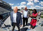 Raiders president Marc Badain, left, Democratic governor candidate Steve Sisolak and Washoe County School Board Trustee Dr. Angie Taylor talk during a tour of the University of Nevada, Reno athletic facilities in Reno, Nev., on Thursday, Aug. 16, 2018. The Raiders are considering several potential training camp locations in Reno. (Cathleen Allison/Las Vegas Review-Journal)