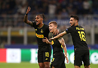 Football Soccer: UEFA Champions League -Group Stage- Group F Internazionale Milano vs  SK Slavia Praha, Giuseppe Meazza stadium, September 17, 2019.<br /> Inter's Nicolò Barella (c) celebrates after scoring with his teammate Valentino Lazaro (l) and Matteo Politano (r) during the Uefa Champions League football match between Internazionale Milano and Slavia Praha at Giuseppe Meazza (San Siro) stadium, September 17, 2019.<br /> UPDATE IMAGES PRESS/Isabella Bonotto