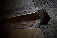 A partially intact wall decoration is seen inside the thermal baths on Friday, Sept. 18, 2015, in Pompeii, Italy. The city of Pompeii was destroyed when nearby Mount Vesuvius erupted on August 24, AD 79. The town and its residents were buried and forgotten until the ruins were discovered and eventually excavated hundreds of years later. The ruins are one of Italy's top tourist attractions today. (Photo by James Brosher)