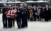 Former President George W. Bush, Laura Bush and other family members watch as the flag-draped casket of former President George H.W. Bush is carried by a joint services military honor guard to Special Air Mission 41, Wednesday, Dec. 5, 2018, at Andrews Air Force Base, Md.<br /> Credit: Alex Brandon / Pool via CNP