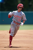 Josh McLain (15) of the North Carolina State Wolfpack rounds the bases after teammate Patrick Bailey (not pictured) hit a home run against the Northeastern Huskies at Doak Field at Dail Park on June 2, 2018 in Raleigh, North Carolina. The Wolfpack defeated the Huskies 9-2. (Brian Westerholt/Four Seam Images)