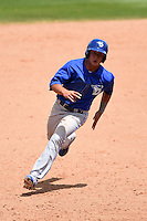 Dunedin Blue Jays second baseman Christian Lopes (14) runs the bases during a game against the Clearwater Threshers on April 6, 2014 at Bright House Field in Clearwater, Florida.  Dunedin defeated Clearwater 5-2.  (Mike Janes/Four Seam Images)
