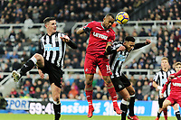 Jordan Ayew of Swansea City (C) heads the ball from a cross but fails to score during the Premier League match between Newcastle United and Swansea City at St James' Park, Newcastle, England, UK. Saturday 13 January 2018