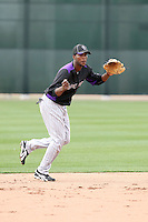 Hector Gomez #64 of the Colorado Rockies participates in spring training workouts at Salt River Fields on February 26, 2011  in Scottsdale, Arizona. .Photo by:  Bill Mitchell/Four Seam Images.