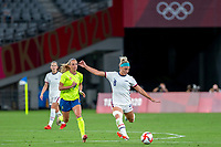 TOKYO, JAPAN - JULY 21: Julie Ertz #8 of the United States on the ball during a game between Sweden and USWNT at Tokyo Stadium on July 21, 2021 in Tokyo, Japan.