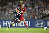 MELBOURNE, AUSTRALIA - OCTOBER 30: Adam Hughes of United holds onto Marvin Angulo of the Victory during the round 12 A-League match between the Melbourne Victory and Adelaide United at Etihad Stadium on October 30, 2010 in Melbourne, Australia.  (Photo by Sydney Low / Asterisk Images)
