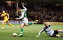 HIBERNIAN'S LEIGH GRIFFITHS TAKES THE ALL AROUND MOTHERWELL'S DARREN RANDOLPH  BEFORE CROSSING FOR ISAIAH OSBOURNE TO SCORE HIBS FIRST