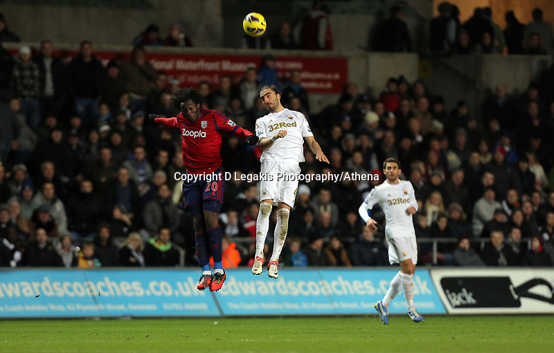 Sunday, 28 November 2012<br /> Pictured: (L-R) Romelu Lukaku and Chico Flores.<br /> Re: Barclays Premier League, Swansea City FC v West Bromwich Albion at the Liberty Stadium, south Wales.