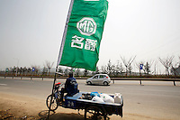 A flag displaying a MG logo at the launching ceremony of the first Chinese built MG vehicles in Nanjing, China. The Chinese company is now in a position to take on Rover's assets and plan its future. It intended to relocate the engine plant and some car production plant to China but to retain some car production plant in the UK..27 Mar 2007
