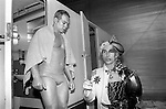 Andrew Logan dressed as two halves of a whole, a man woman figure. He organised the Alternative Miss World competition Olympia 1981