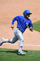 Dunedin Blue Jays shortstop Jorge Flores (2) runs the bases during a game against the Clearwater Threshers on April 6, 2014 at Bright House Field in Clearwater, Florida.  Dunedin defeated Clearwater 5-2.  (Mike Janes/Four Seam Images)