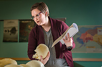 Graduate student and TA Emily Corley helps undergrad students learn to identify features of the human skull using models during Professor Ryan Harrod's Biological Anthropology Lab (ANTH A205L) in UAA's Beatrice McDonald Hall.