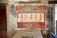 The Thermopolium of Lucius Vetutius Placidus on the Via del Abbondante, with the serving counter with holes that contained amphora of food for sale. The Thermopolium was an eating & drinking house. The painting depicts at the centre the God of the patron and on either side are the lars or protectors of the house, Mercury , God of Commerce & Dionysus, God of wine.