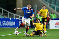 SYDNEY, AUSTRALIA - JULY 31, 2010: Gentzoglou Savvas of AEK Athens lays a tackle during the match between AEK Athens FC and Glasgow Rangers at the 2010 Sydney Festival of Football held at the Sydney Football Stadium on July 31, 2010 in Sydney, Australia. (Photo by Sydney Low / www.syd-low.com)