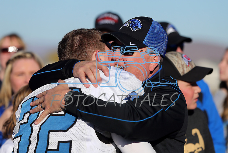 Pahranagat Valley Head Coach Ken Higbee and his son Christian celebrate after defeating Whittell 54-28 in the NIAA DIV championship game at Dayton High School in Dayton, Nev., on Saturday, Nov. 21, 2015. (Cathleen Allison/Las Vegas Review Journal)