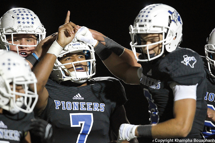 Boswell senior quarterback Anthony Ramirez is congratulated after his 15-yard touchdown run in the fourth quarter against Denton in district 5-5A high school football in Fort Worth on Friday, October 2, 2015. Boswell won 44-38. (photo by Khampha Bouaphanh)