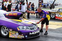 Aug. 19, 2011; Brainerd, MN, USA: John Nobile directs his son NHRA pro stock driver Vincent Nobile into the staging beams during qualifying for the Lucas Oil Nationals at Brainerd International Raceway. Mandatory Credit: Mark J. Rebilas-