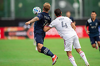LAKE BUENA VISTA, FL - JULY 22: Johhny Russell #7 of Sporting Kansas City heads the ball during a game between Real Salt Lake and Sporting Kansas City at Wide World of Sports on July 22, 2020 in Lake Buena Vista, Florida.