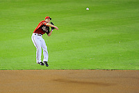 Aug. 16, 2009; Phoenix, AZ, USA; Arizona Diamondbacks shortstop Stephen Drew makes a leaping through to first base in the fifth inning against the Los Angeles Dodgers at Chase Field. Mandatory Credit: Mark J. Rebilas-