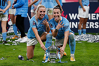 1st November 2020; Wembley Stadium, London, England; Womens FA Cup Final Football, Everton Womens versus Manchester City Womens; Lucy Bronze and Rose Lavelle of Manchester City pose with the Womens FA Cup Final Trophy