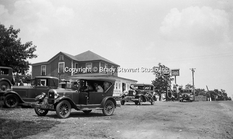 Harrisonville PA: The Stewart's taking a break while driving along Route 30 in Fulton County.  The Stewart's 1929 Chevy Coach and other cars stopped for gas at Bud Myers Gulf on Route 30.
