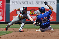 Memphis Redbirds shortstop Matt Williams (7) fields the ball as Iowa's David Freitas (38) slides into second base during the Pacific Coast League game against the Iowa Cubs at Principal Park on June 7, 2016 in Des Moines, Iowa.  Iowa won 6-5.  (Dennis Hubbard/Four Seam Images)