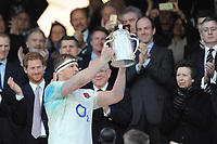 Prince Harry and Princess Anne looks on as Dylan Hartley of England lifts the Calcutta Cup during the RBS 6 Nations match between England and Scotland at Twickenham Stadium on Saturday 11th March 2017 (Photo by Rob Munro/Stewart Communications)