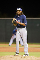AZL Padres 2 relief pitcher Vijay Miller (14) gets ready to deliver a pitch during a game against the AZL Rangers on August 2, 2017 at the Texas Rangers Spring Training Complex in Surprise, Arizona. Padres 2 defeated the Rangers 6-3. (Zachary Lucy/Four Seam Images)