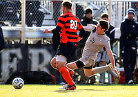 WASHINGTON, DC - NOVEMBER 25, 2012: Andy Riemer (20) of Georgetown University goes for a loose ball with Chris Makowski (20) of Syracuse University during an NCAA championship third round match at North Kehoe field, in Georgetown, Washington DC on November 25. Georgetown won 2-1 after overtime and penalty kicks.