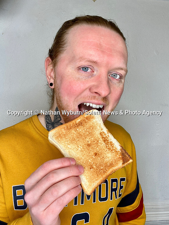 Pictured:  Artist Nathan Wyburn<br /> <br /> An artist has created the ultimate 'love or hate' collage - a portrait of Piers Morgan drawn with Marmite on toast.  The impressive work was made by spreading a jar of the yeast extract spread onto 35 slices of toast, and took three painstaking hours to complete.<br /> <br /> Morgan, 55, quit ITV's flagship breakfast show Good Morning Britain this week after storming out when his comments about Meghan, Duchess of Sussex again polarised opinion.  Ofcom received over 41,000 complaints from viewers, including a complaint from the Duchess of Sussex herself.  SEE OUR COPY FOR DETAILS.<br /> <br /> Please byline: Nathan Wyburn/Solent News<br /> <br /> © Nathan Wyburn/Solent News & Photo Agency<br /> UK +44 (0) 2380 458800