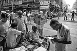 In the early morning old people reads newspaper at a newspaper stall in Kolkata