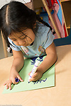 Education Preschool 4 year olds closeup of child using left hand to write letters of name