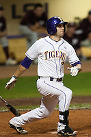 LSU Tigers designated hitter Grant Dozar #7 delivers a game tying 10th inning RBI double against the Mississippi State Bulldogs during the NCAA baseball game on March 16, 2012 at Alex Box Stadium in Baton Rouge, Louisiana. LSU defeated Mississippi State 3-2 in 10 innings. (Andrew Woolley / Four Seam Images).