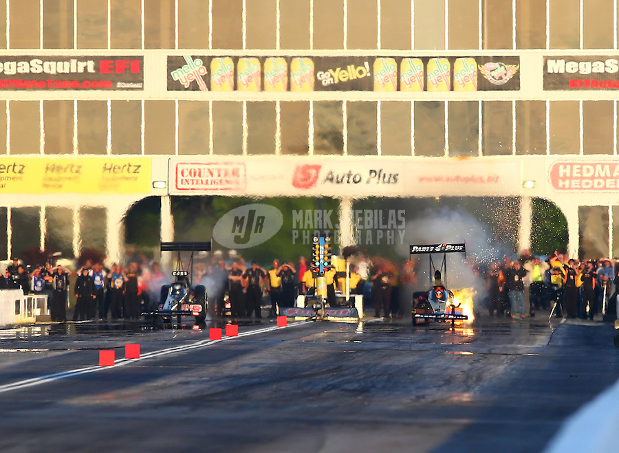 May 18, 2014; Commerce, GA, USA; NHRA top fuel driver Clay Millican (right) explodes his engine as Bob Vandergriff Jr loses traction during the Southern Nationals at Atlanta Dragway. Mandatory Credit: Mark J. Rebilas-USA TODAY Sports