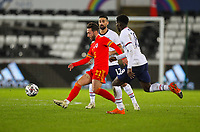 12th November 2020; Liberty Stadium, Swansea, Glamorgan, Wales; International Football Friendly; Wales versus United States of America; Josh Sheehan of Wales passes the ball while under pressure from Sebastian Lletget and Yunus Musah of USA