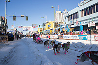 DeeDee Jonrowe and team leave the ceremonial start line with an Iditarider and handler at 4th Avenue and D street in downtown Anchorage, Alaska on Saturday March 4th during the 2017 Iditarod race. Photo © 2017 by Brendan Smith/SchultzPhoto.com.