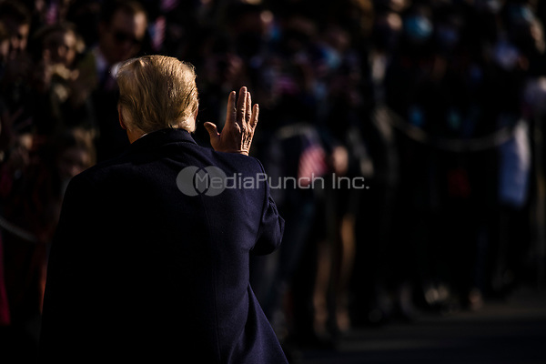 United States President Donald J. Trump waves to supporters as he departs the White House in Washington, D.C., U.S., on Tuesday, Jan. 12, 2021. The President is heading to Alamo, Texas today to visit the border wall between the United States and Mexico. This is the Presidents first appearance following the insurrection at the U.S. Capitol by his followers last week. <br /> Credit: Samuel Corum / Pool via CNP /MediaPunch