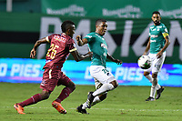 PALMIRA – COLOMBIA, 21-03-2021: Jhojan Valencia del Cali disputa el balón con Cristian Trujillo del Deportes Tolima durante el partido entre Deportivo Cali y Deportes Tolima por la fecha 13 de la Liga BetPlay DIMAYOR 2021 jugado en el estadio Deportivo Cali de la ciudad de Palmira. / Jhojan Valencia of Cali vies for the ball with Cristian Trujillo of Deportes Tolima during match between Deportivo Cali and Deportes Tolima for the date 13 as part of BetPlay DIMAYOR League 2021 played at the Deportivo Cali stadium in Palmira city. Photos: VizzorImage / Nelson Ríos / Cont.