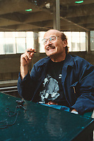 August 2000, Montreal, Quebec, Canada<br /> <br /> German film maker Volker Schloendorf, hold  a cigar while giving at interview, at the 2000 World Film Festival in Montreal, Canada