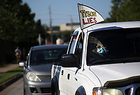 Protestors hold up signs, Friday, May 29, 2020 during a protest caravan and rally at the Tyson Foods plant at 600 Berry St. in Springdale. A poultry workers' rights group, Venceremos, hosted a rally and car caravan to protest how workers are being treated in relation to covid-19. Check out nwaonline.com/200530Daily/ for today's photo gallery. <br /> (NWA Democrat-Gazette/Charlie Kaijo)