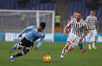 Calcio, Serie A: Lazio vs Juventus. Roma, stadio Olimpico, 4 dicembre 2015.<br /> Juventus' Paulo Dybala, right, celebrates with teammate Lazio's Keita Balde Diao, left, is chased by Juventus' Leonardo Bonucci during the Italian Serie A football match between Lazio and Juventus at Rome's Olympic stadium, 4 December 2015.<br /> UPDATE IMAGES PRESS/Isabella Bonotto