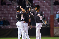 Salem-Keizer Volcanoes center fielder Aaron Bond (51) is congratulated by David Villar (5) and Wander Franco (23) after hitting a home run during a Northwest League game against the Eugene Emeralds at Volcanoes Stadium on August 31, 2018 in Keizer, Oregon. The Eugene Emeralds defeated the Salem-Keizer Volcanoes by a score of 7-3. (Zachary Lucy/Four Seam Images)