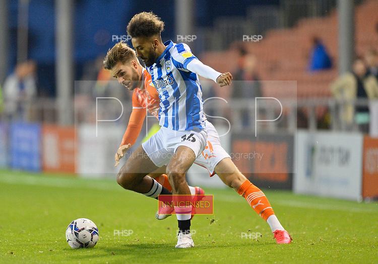 14/09/2021 Sky Bet Championship Blackpool v Huddersfield Town  <br /> Sorba Thomas challenged by Luke Garbutt