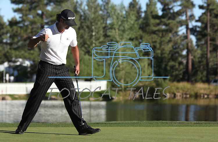 Scott Piercy celebrates after sinking the winning putt on the 18th green at the Reno-Tahoe Open at the Montreux Golf & Country Club in Reno, Nev., on Sunday, Aug. 7, 2011. .Photo by Cathleen Allison